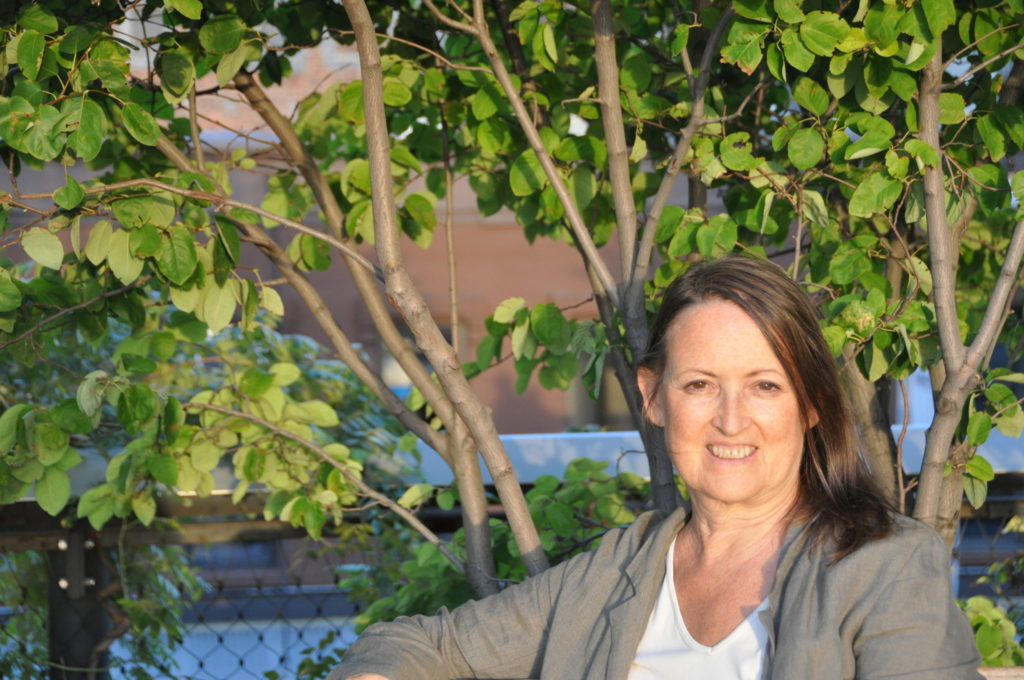 Pamela Miles of Reiki, Self Care and Medicine, Sitting outside on a bench