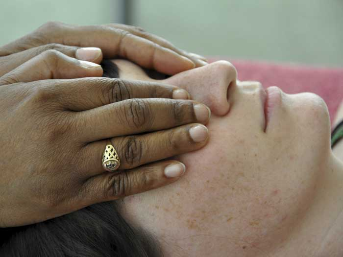 Student practicing giving Reiki session in Reiki training with Pamela Miles